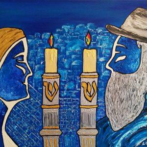 Une femme et un homme devant deux bougies